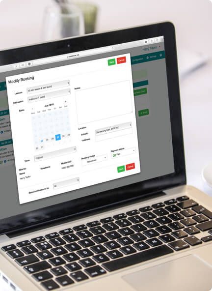 Laptop showing online booking system dashboard