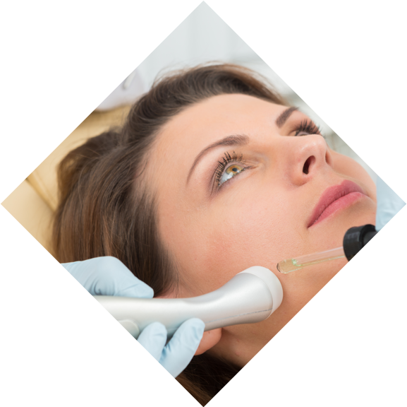 Woman lying down having a laser facial treatment